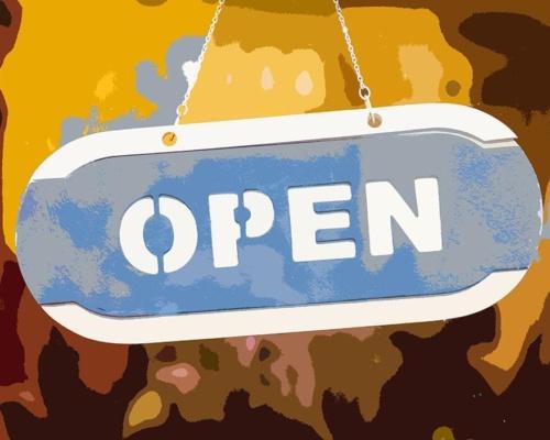 Wood open sign at the mirror door of store